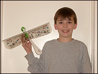 McGorry, 10, holds his new dragonfly robot.