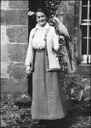Girl Scout founder Juliette Gordon Low with a parrot.