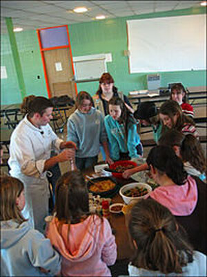 Girl Scouts learn to cook on a hot plate.