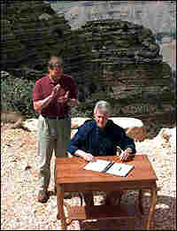 President Bill Clinton signs an order to designate Grand Staircase-Escalante national monument.