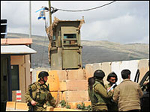 Israeli soldiers inspect cars at a checkpoint near the northern West Bank village of Beit Furik.