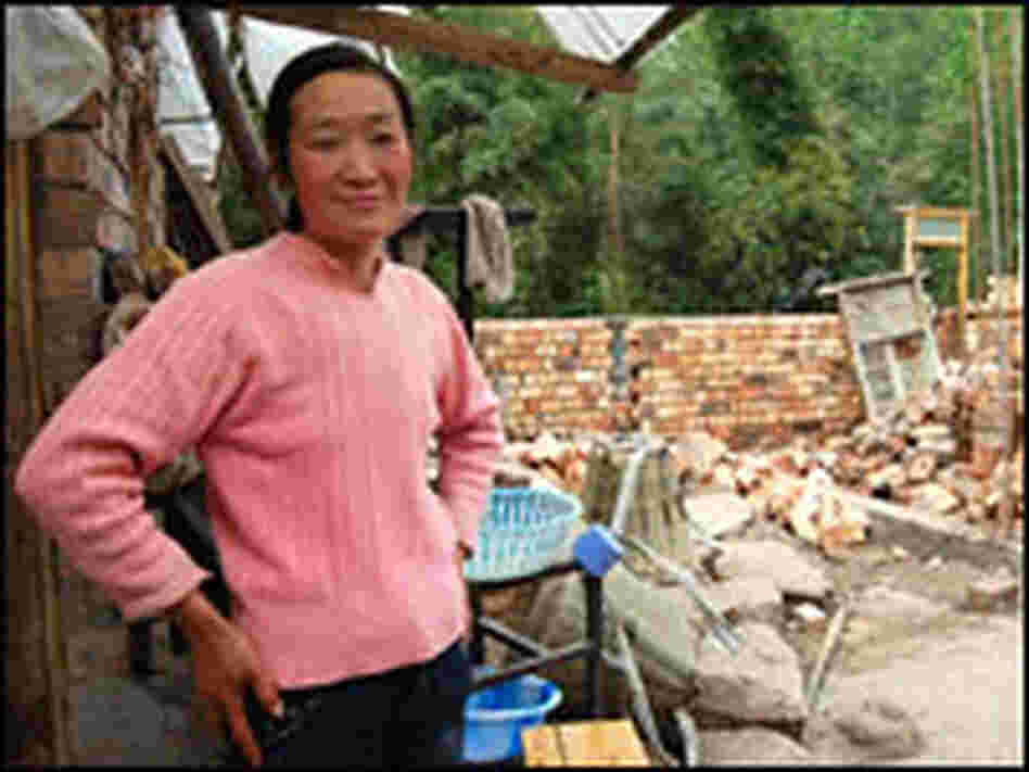 Yao Suhui stands on the site that will become her new home.