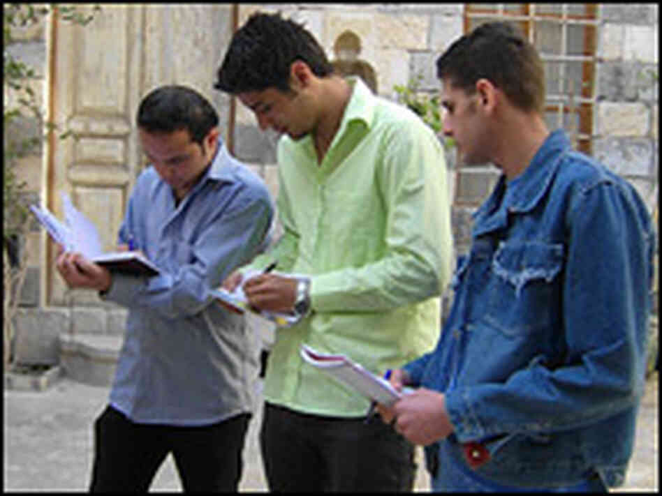 Students participate in a writing workshop in Syria.