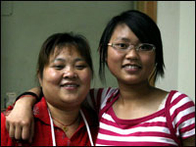 Bamboo (right), who is an only child, stands with her mother.