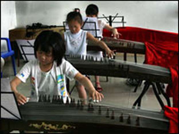Children play the guzheng, a Chinese horizontal harp, at the Long Yun Gu Zheng Training Academy in Chengdu.