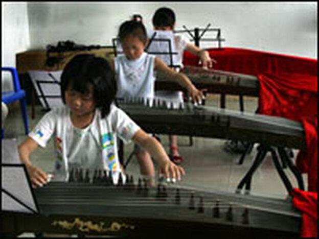 Children play the guzheng, a Chinese horizontal harp, at the Long Yun Gu Zheng Training Academy in Chengdu.