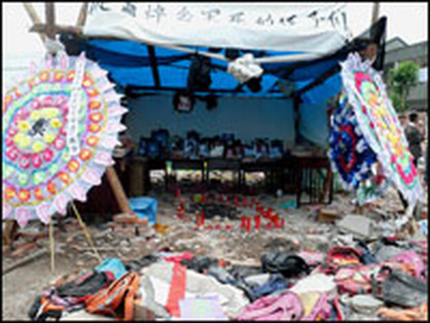 At the Fuxing primary school in Wufu, parents erected an altar to remember their children. At least 127 children died when the school collapsed on them.