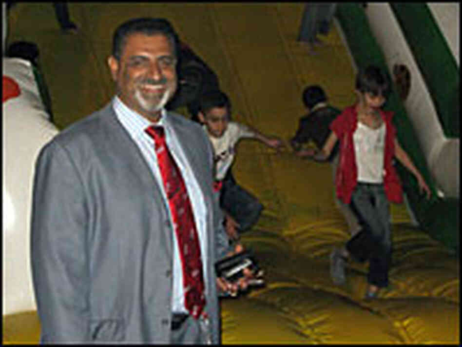 Hatim al-Bachary stands in front of one of the attractions at his newly opened amusement park.