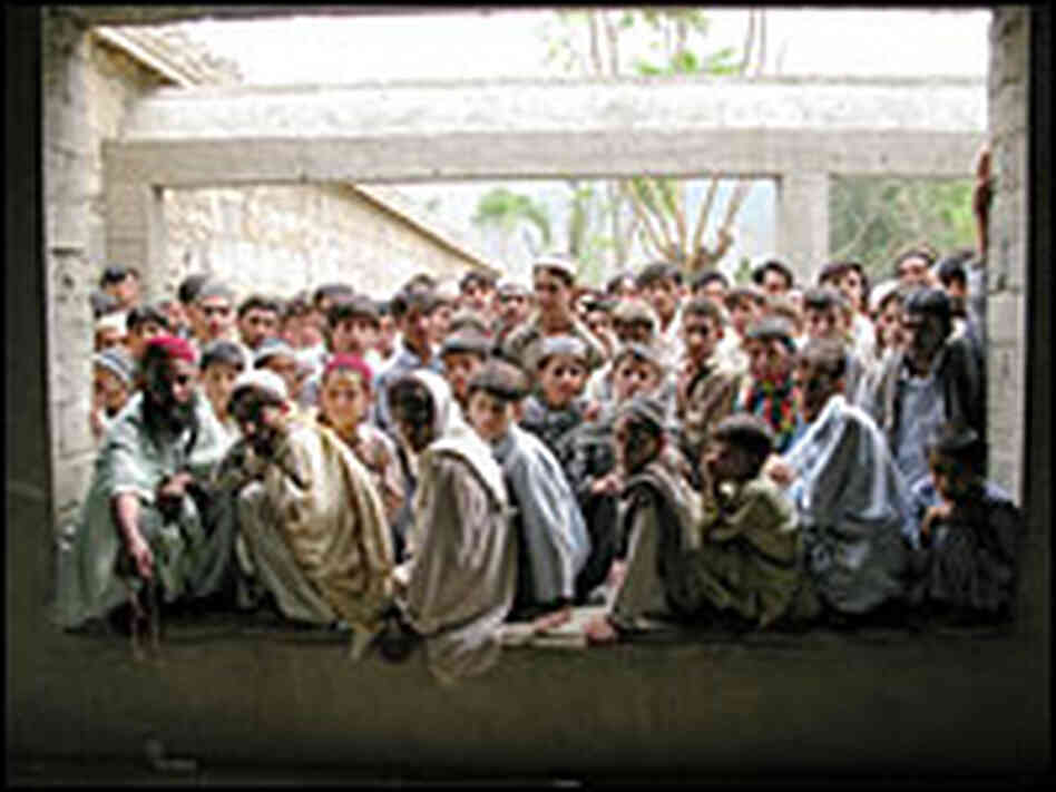 Refugees wait for food in Kunar Province, Afghanistan