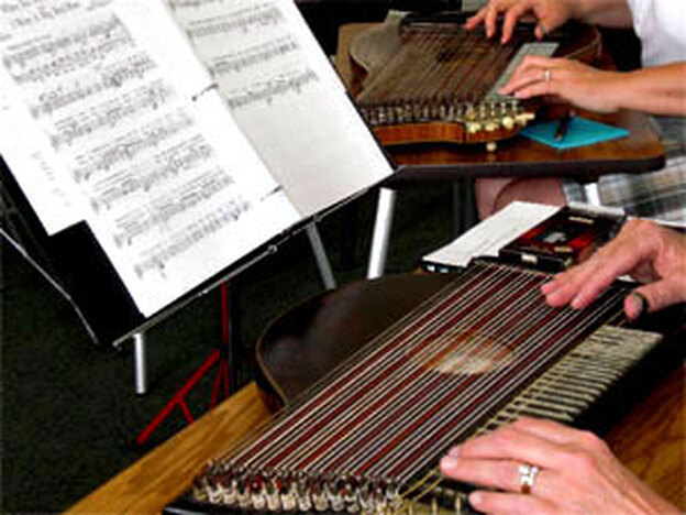 Zithers in action at a rehearsal of the Davenport Zither Ensemble.