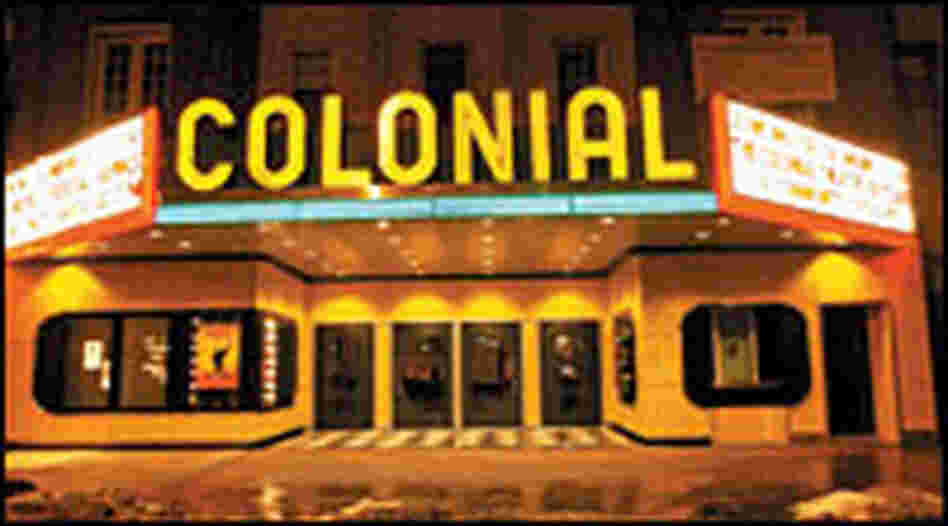 Colonial Theatre marquee at night, neon lit