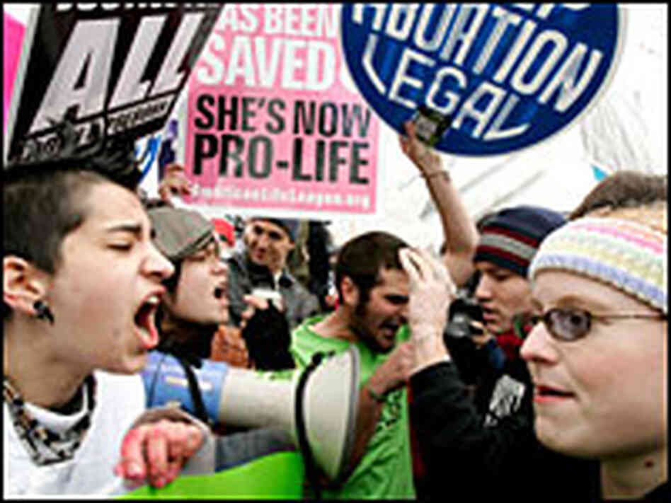 Abortion rights activists argue with abortion opponents.