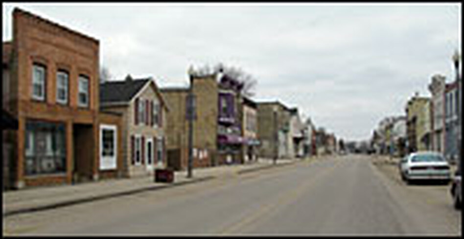 Lake Street, a bustling thoroughfare in Hustisford through the mid-1900s, is now quiet and deserted, though many of the original storefronts remain.