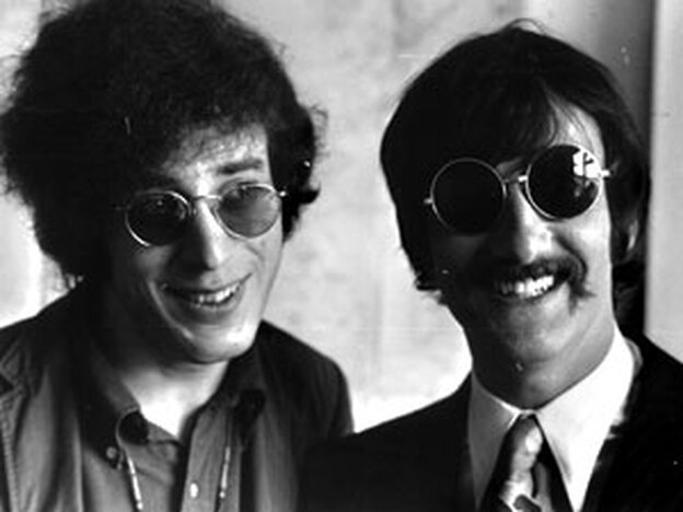Procol Harum lyricist and manager Keith Reid (left) with the group's former manager, Tony Secunda, in 1967. (Express/Getty Images)