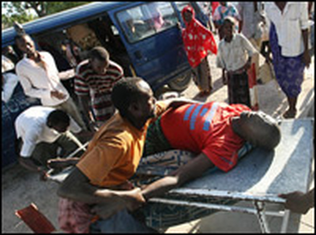 A Somali man is rushed to the hospital after a mortar attack that targeted Payne during his one-day visit to Mogadishu.