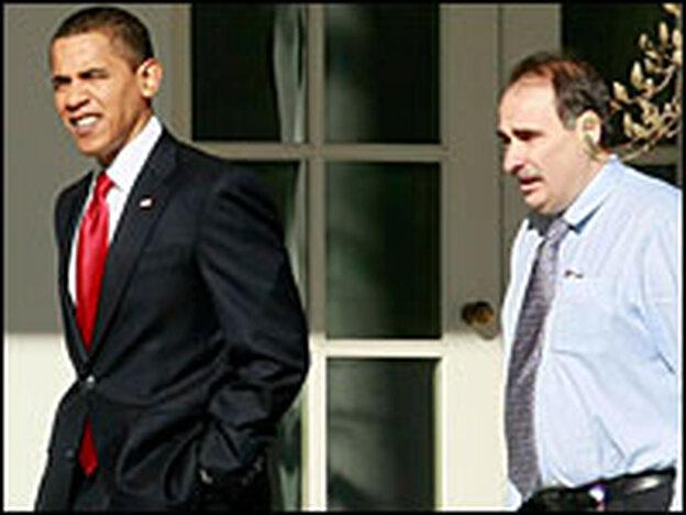 President Obama walks with his senior adviser, David Axelrod, outside the White House on Tuesday.