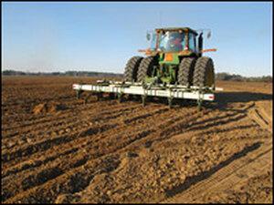 Peanut tractor rakes for peanuts.