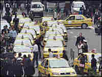Local residents and police surround taxis parked in Chongqing