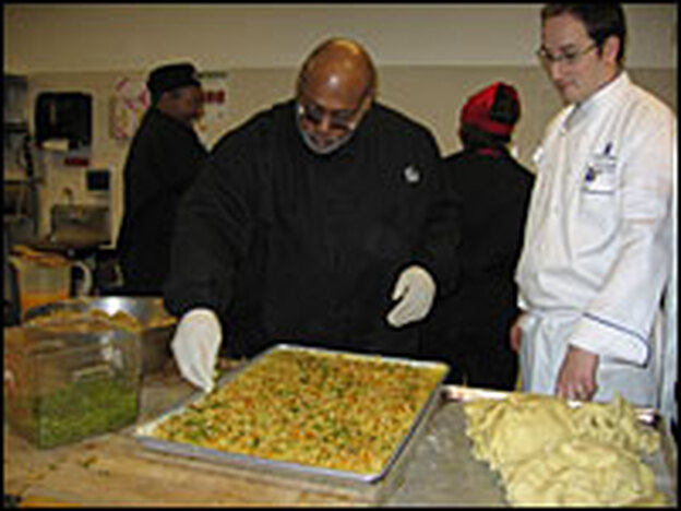 Curtis Cunningham prepares Michelle Obama's cookie recipe as chef Jerome Girardot watches and provides advice.  About 8,000 cookies will be made.