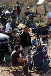 Members of the media report along the Israeli-Gaza border in Israel on Wednesday.