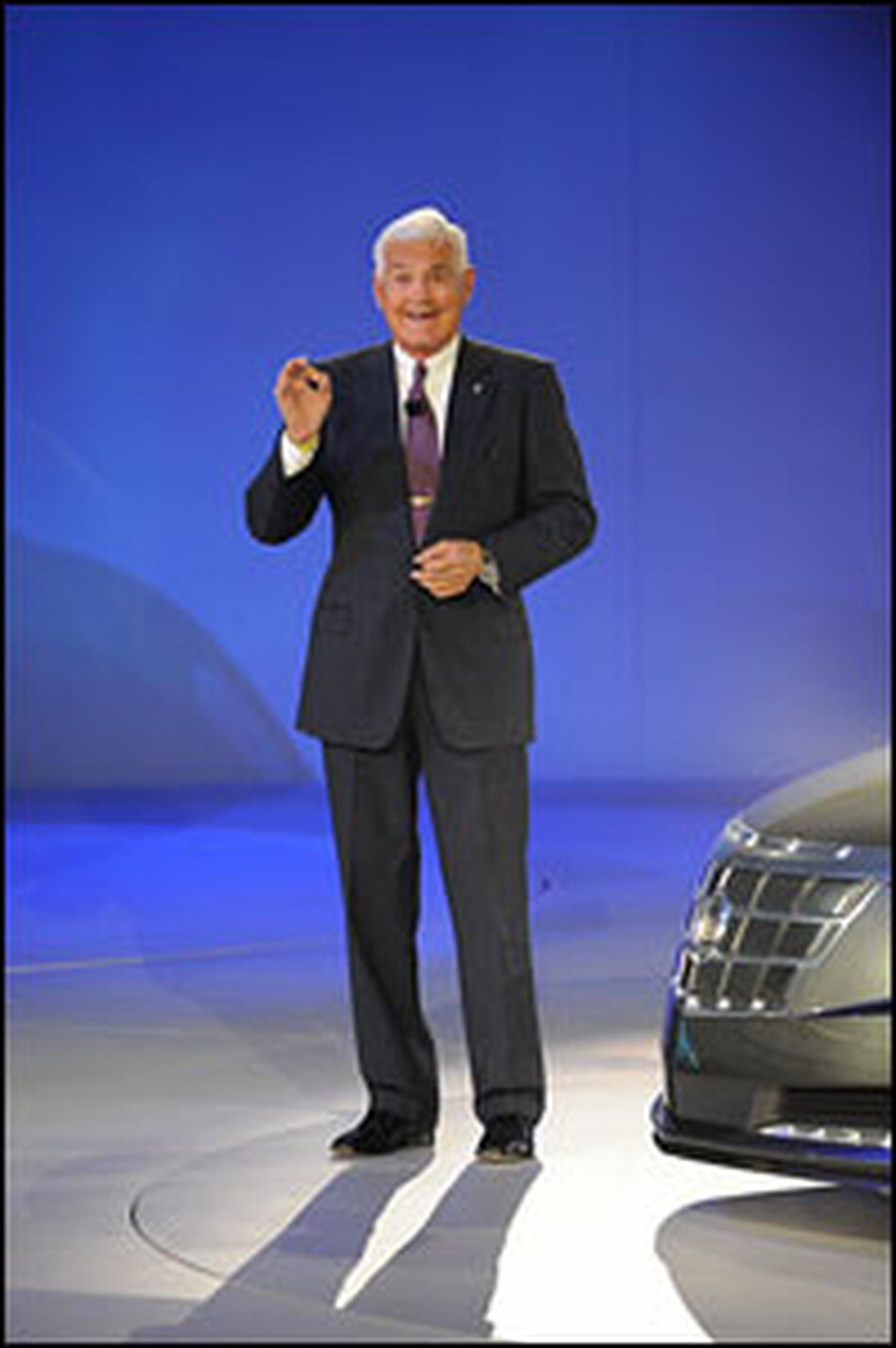 GM Vice Chairman Bob Lutz unveils the Cadillac Converj electric car Sunday at the North American International Auto Show in Detroit.