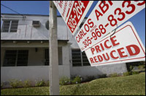 A sign touts a price cut for a Miami house in January.