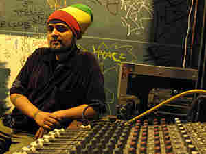 Erick Santero sits in a DJ booth at Luka's Taproom & Lounge in Oakland, California.