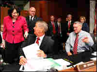Sotomayor greets Sen. Lindsey Graham (R-SC), center, and Sen. Jon Kyl (R-AZ), right, on Thursday.