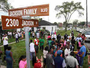 People gather around the childhood home of Michael Jackson in Gary, Ind.