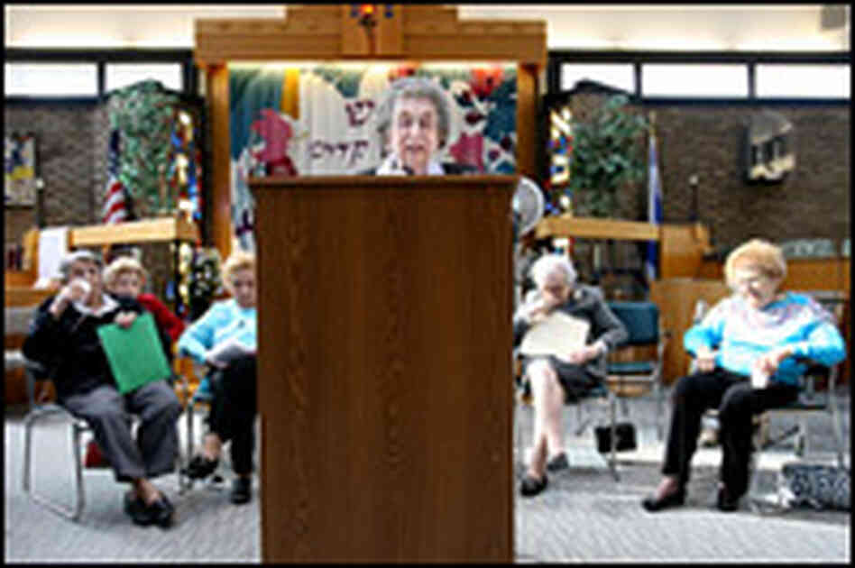 Wish, at the lectern, is one of 10 women ages 89 to 96 who will be bat mitzvahed.