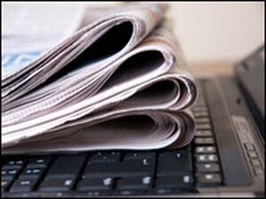 Newspaper with laptop