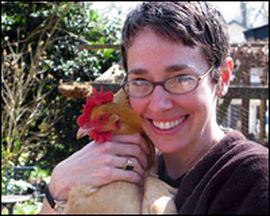 Allison Adams with Ethel, one of her seven hens.