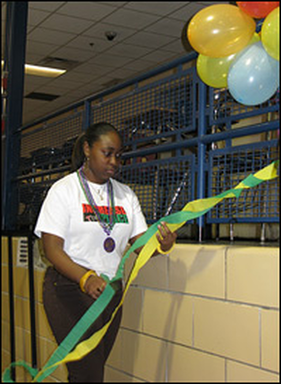 "Simeon senior Diedra Barnes decorates the high school gym for a Mardi Gras party on a recent Friday night. ""Your mind is immune to the violence,"" Barnes says."