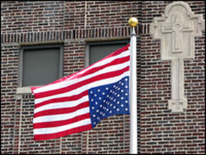 An upside-down flag flies outside of St. Sabina Catholic church and school on Chicago's South S