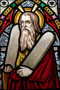 A stained glass window showing Moses holding the Ten Commandments.