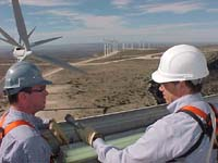 Reporter Howard Berkes (R) atop a wind turbine