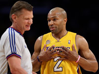 L.A. Laker Derek Fisher with referee Steve Javie.