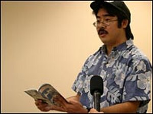 Pidgin scholar Lee Tonouchi reads from one of his books on the subject