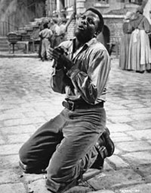 Sidney Poitier plays Porgy in the 1959 film version of 'Porgy and Bess'