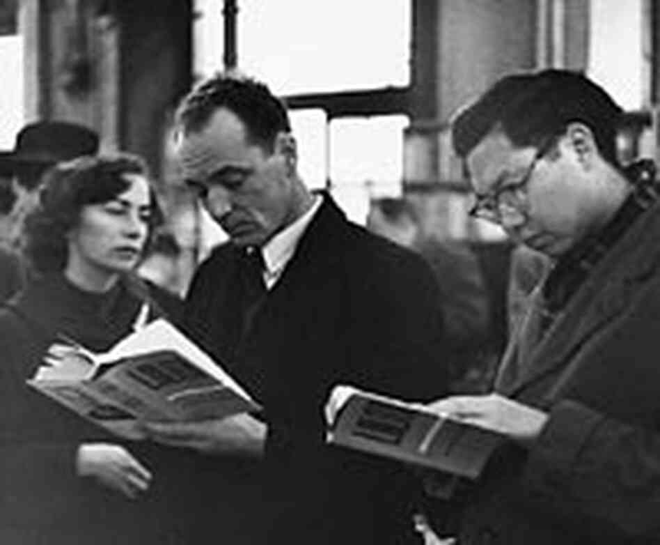 Customers in a London bookstore with copies of 'Lolita' circa 1959