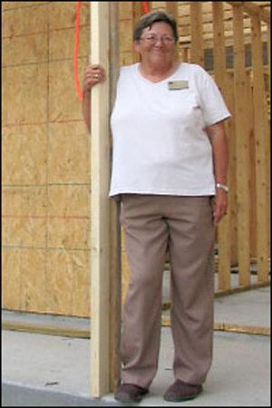 Mary Perkins at her new house under construction. Credit: Howard Berkes, NPR.