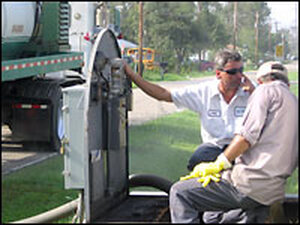 Men repair the Bay Saint Lewis sewer system. Credit: Roland Arrieta, NPR.