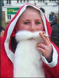 Santa's helper smokes.