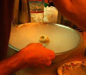 Creating Nitro Pumpkin Seed Pie Horchata Foam over a bath of liquid nitrogen.