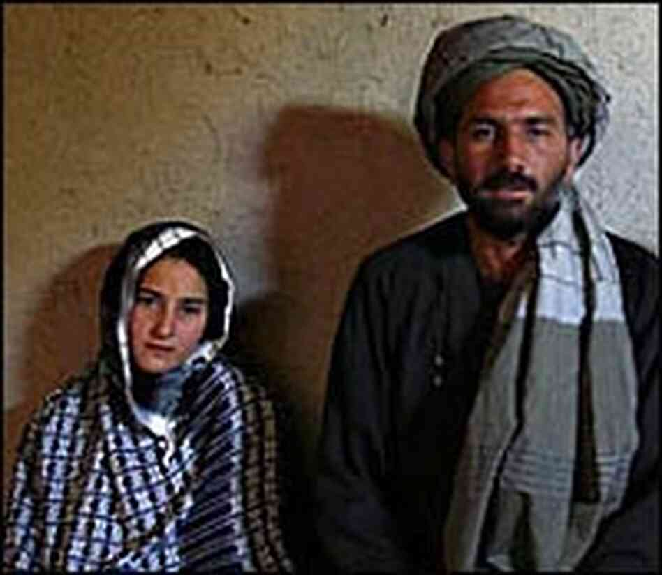 Majabin Mohammed, 13, at left, sits with her husband of six months, Mohammed Fazal, 45.