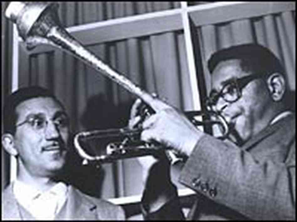 Dizzy Gillespie demostrates his signature trumpet style on his world tour.