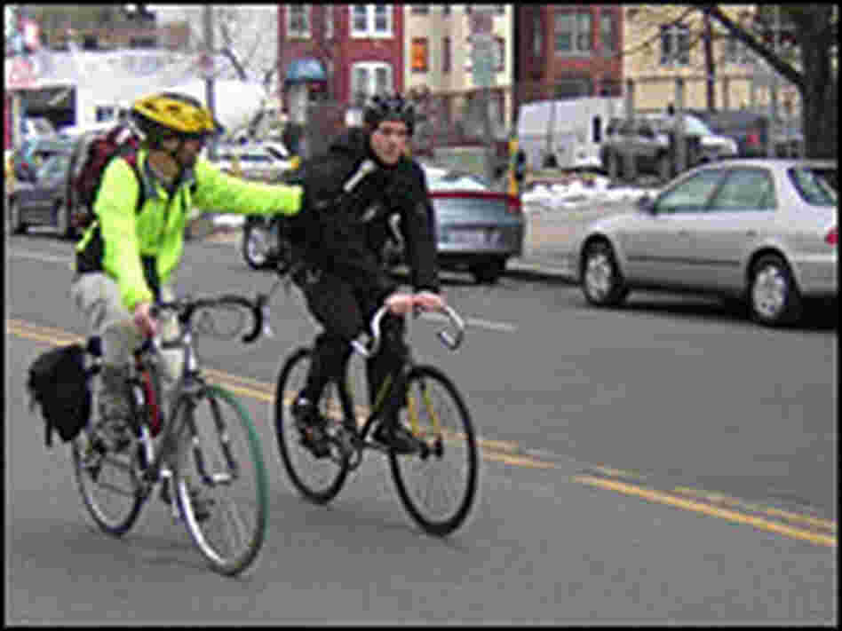 Dan Charles, left, rides with Vincent Betette in Washington, D.C.
