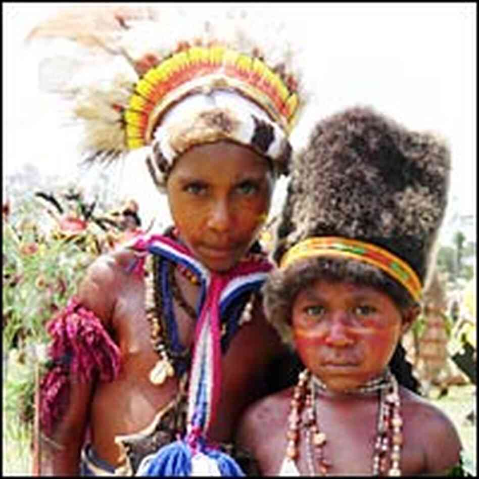 A pair of performers stands in Goroka.