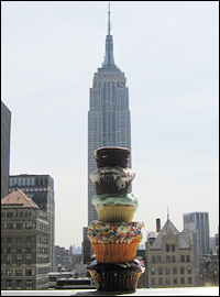 Empire State Building behind stack of cupcakes