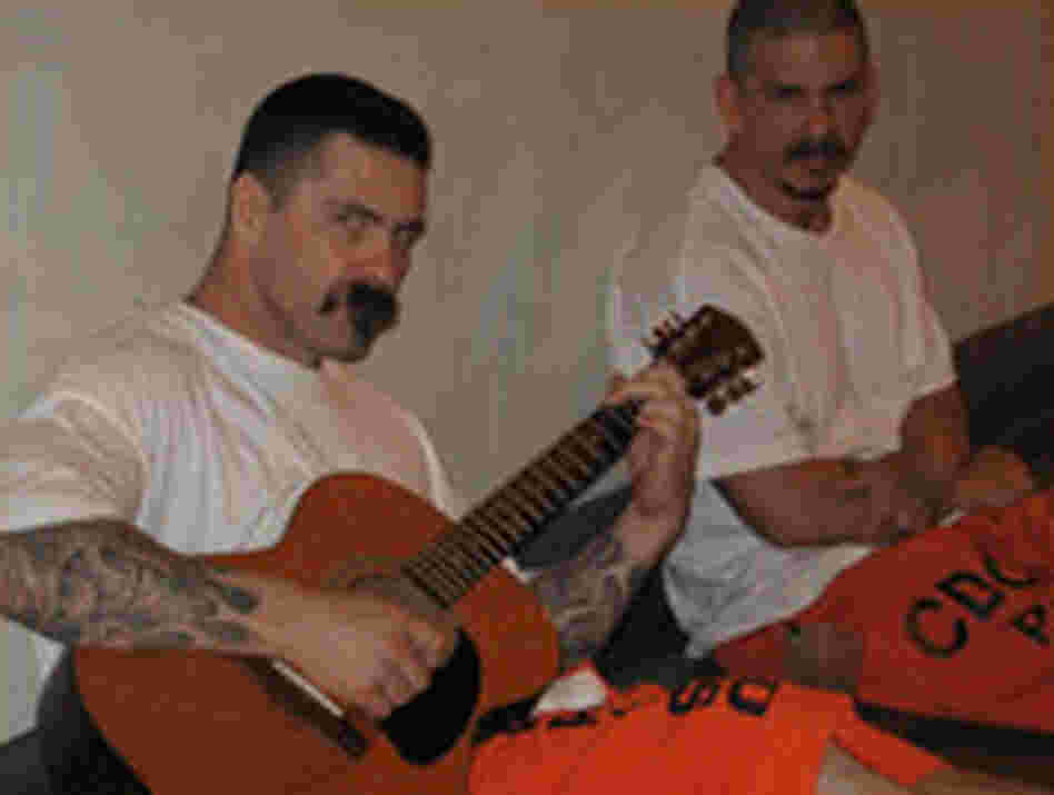 Two inmates with a guitar